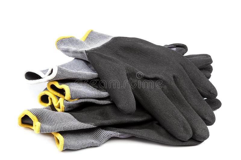 Working gloves on a white background. Working gloves isolated on a white background stock image