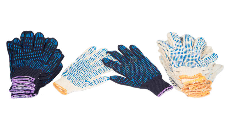 Working gloves. Work gloves black white cotton isolated background royalty free stock photos