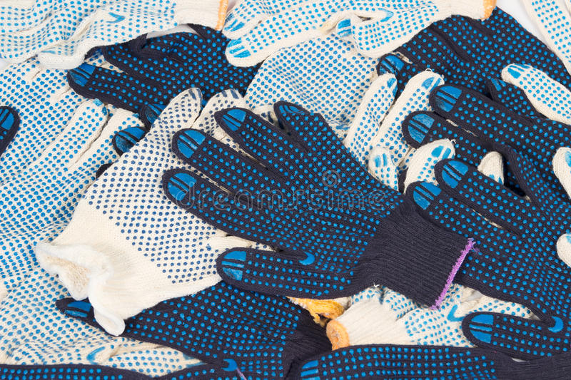 Working gloves. Work gloves black white cotton isolated background stock images