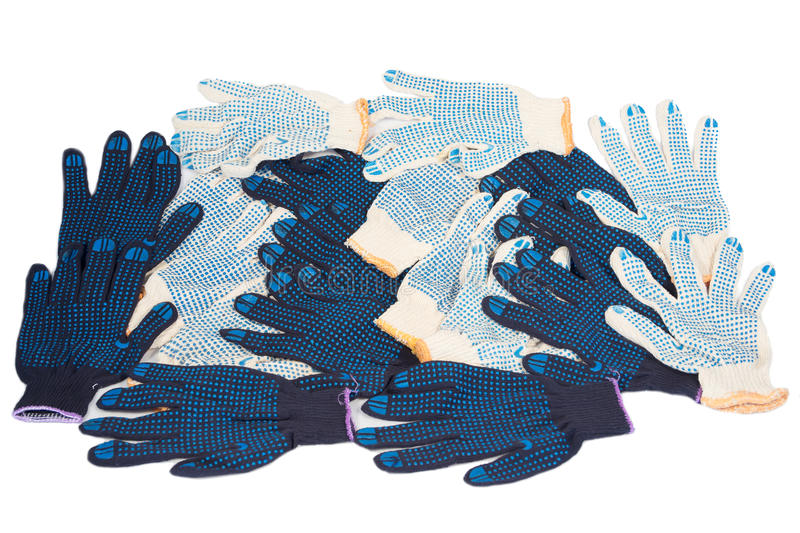 Working gloves. Work gloves black white cotton isolated background stock image