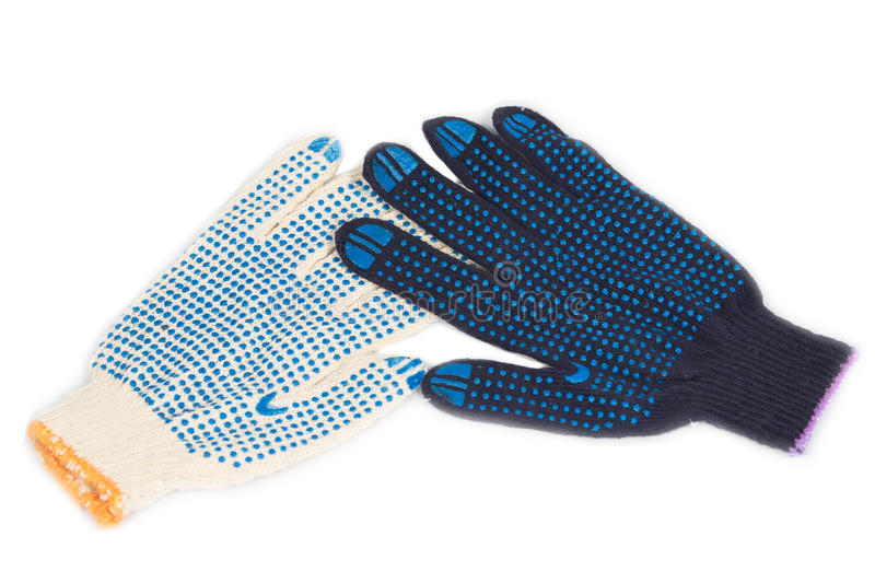 Working gloves. Work gloves black white cotton isolated background royalty free stock image