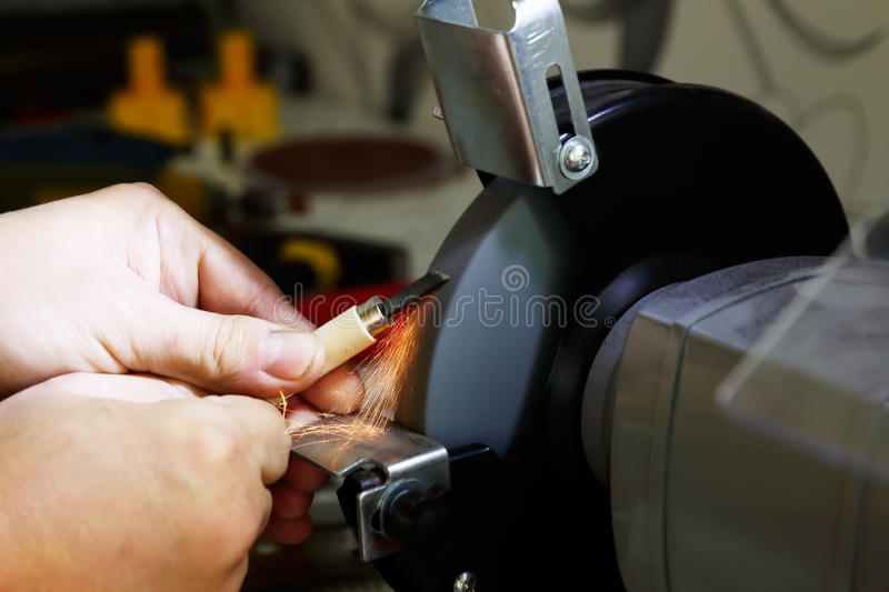 Working on the grinding machine stock photography