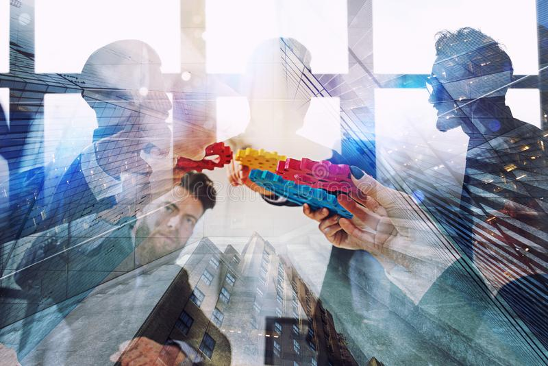 Working group of businessmen find the agreement by holding a piece of gear in hand. concept of teamwork and business. Work of the parts leading to the result stock illustration
