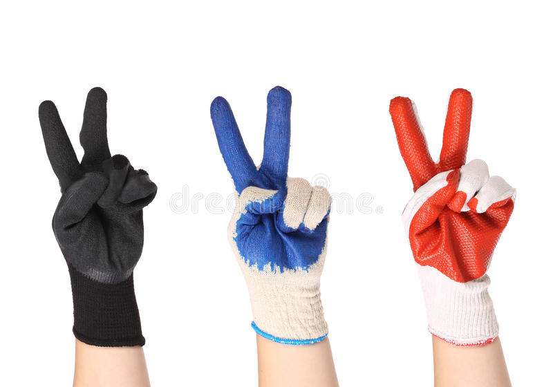 Working hands in gloves. Showing the victory simbol stock images