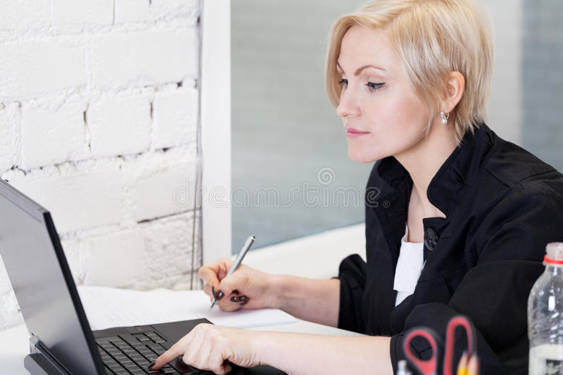Working hard. Business woman working hard in office royalty free stock photo