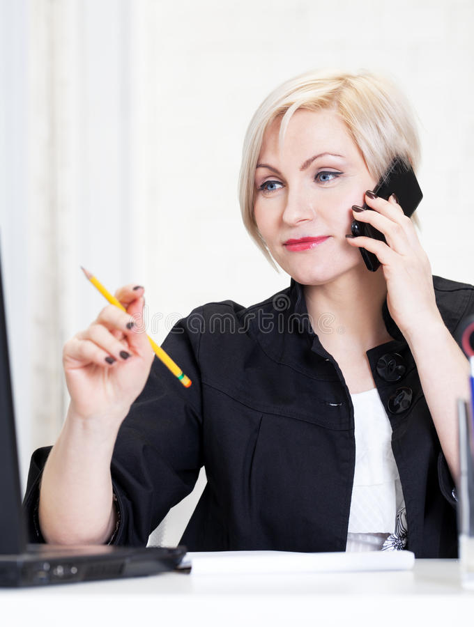 Working hard. Business woman working hard in office stock photography