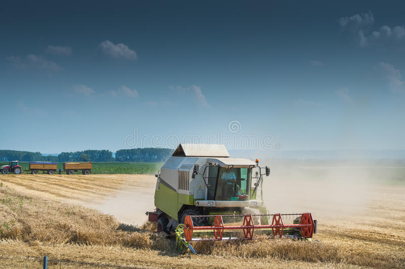 Working Harvesting Combine royalty free stock image