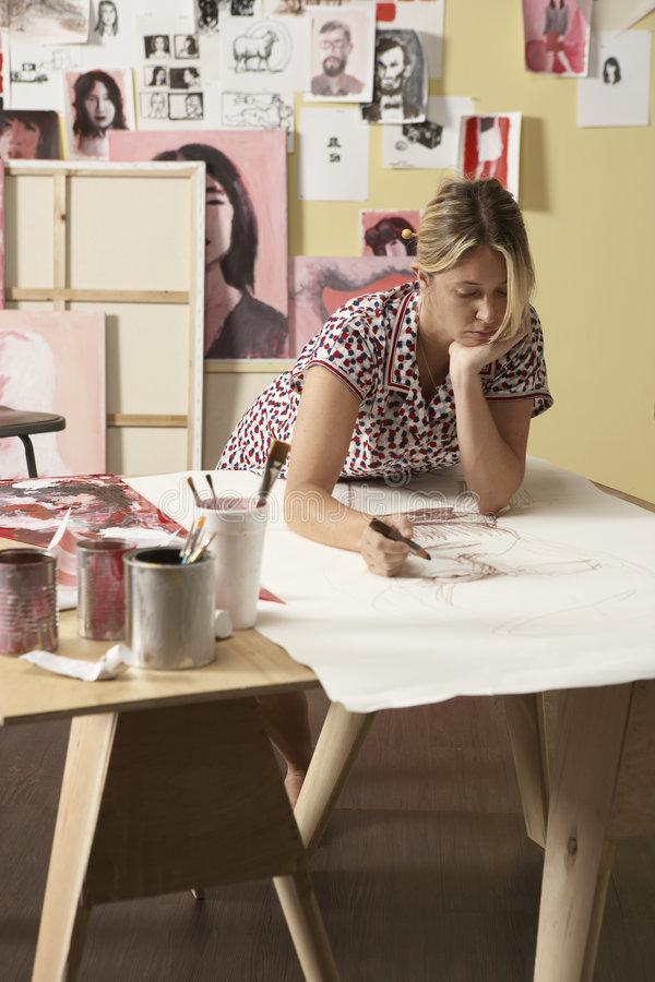 Working on her art studio royalty free stock images