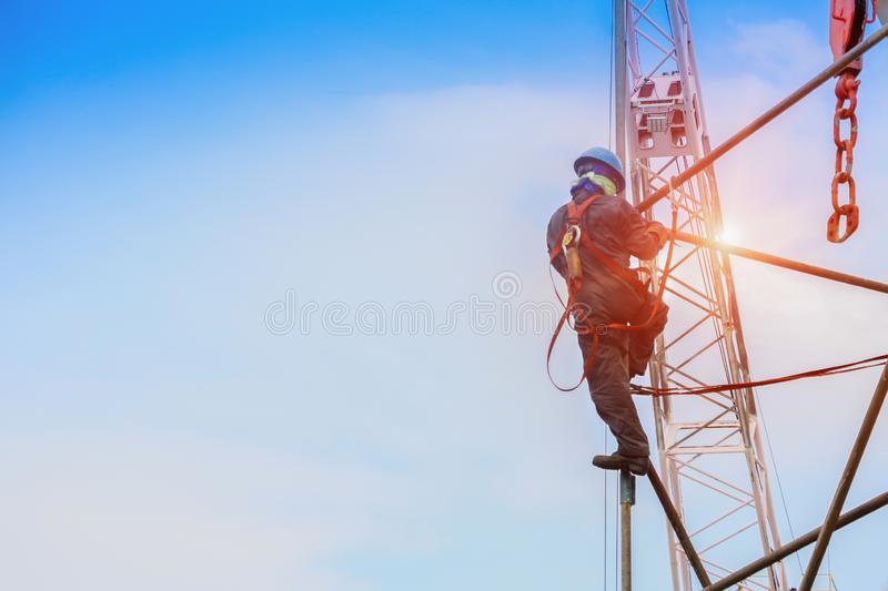 Working on hith with scaffolding with equipment protective on crane background for safety concept.. Safety concept, Construction worker wearing safety harness royalty free stock images