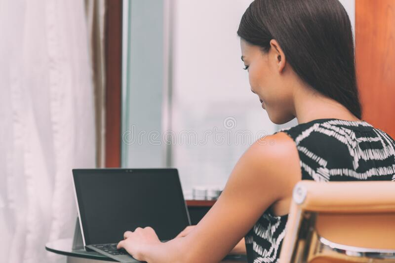 Working from home remote work freelance worker employee woman typing using laptop computer online communication for stock photos
