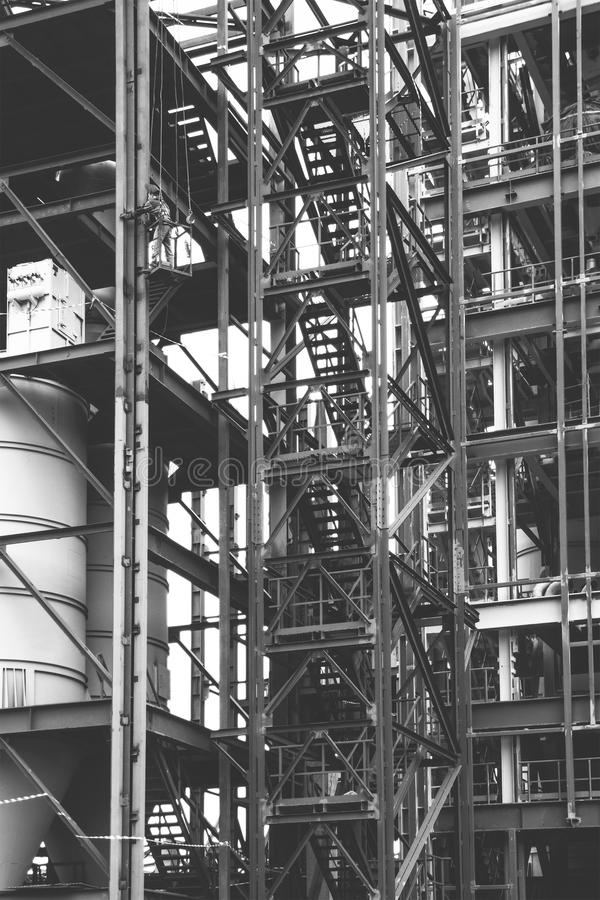 Working installer industrial climber working at a height on the installation of metal structures royalty free stock images