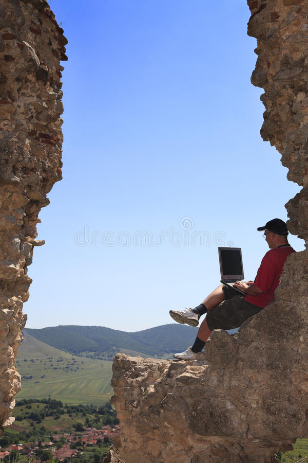Working on a laptop stock images