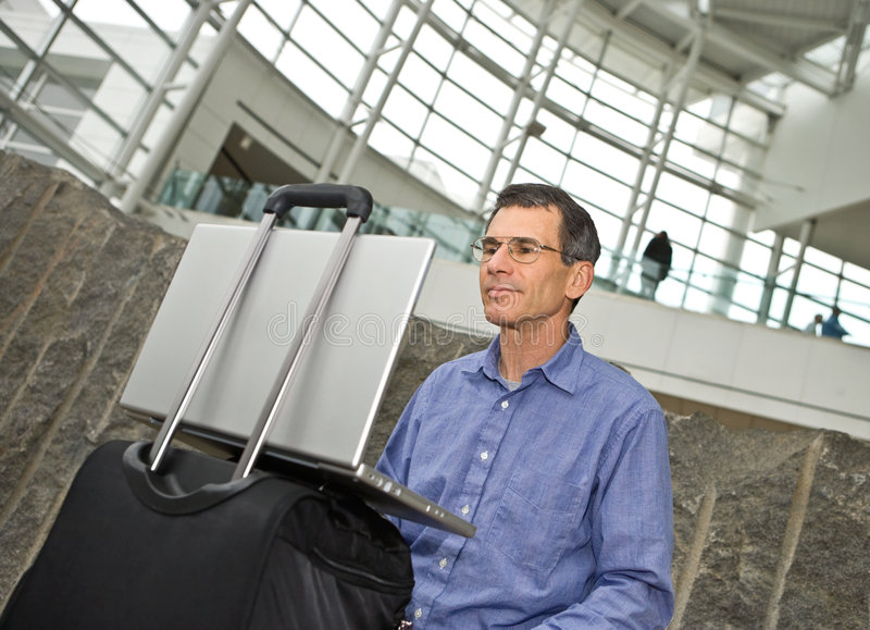 Working on Laptop in Airport T royalty free stock photo