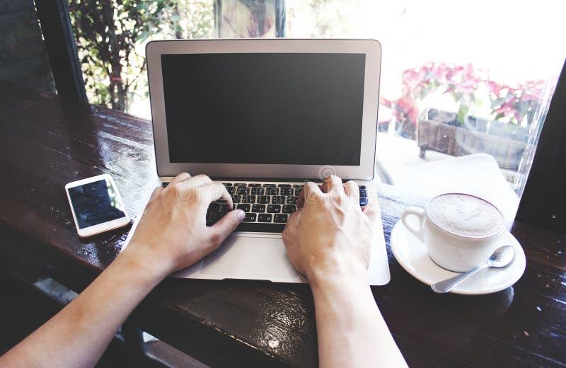 Working on laptop. stock image