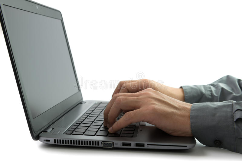 Working on laptop computer royalty free stock image