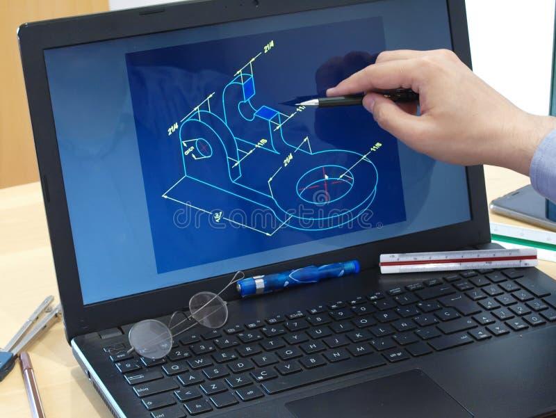 Working at laptop designing 3d print piece stock image