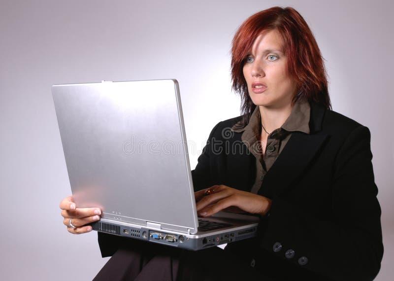 Working on laptop III stock image
