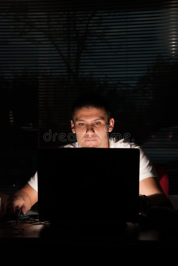 Working late stock photography