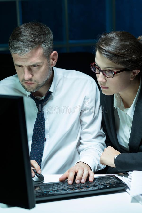 Working late office workers royalty free stock image