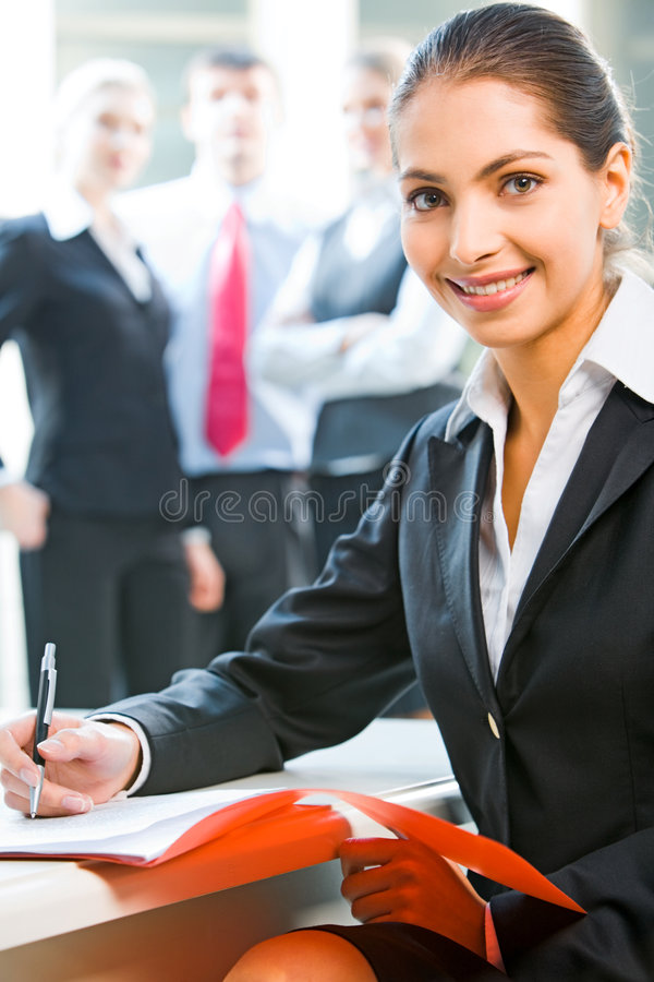 A working leader. A successful business leader sitting at the table with a document lying on it royalty free stock photography