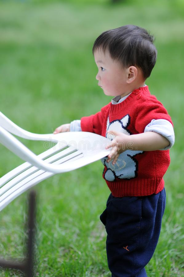 Working little boy stock photography