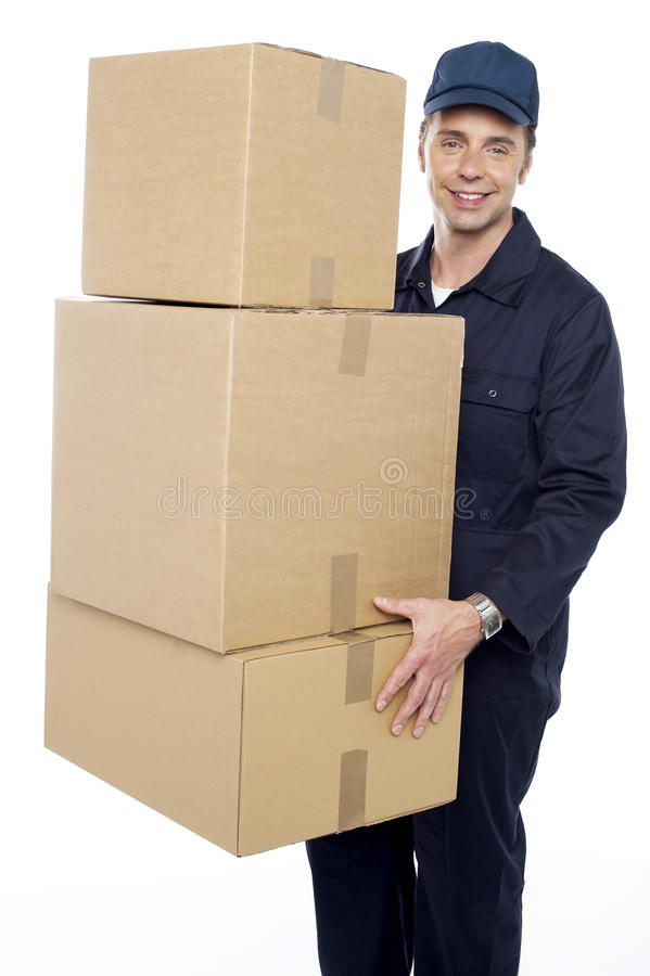 Working man delivering stack of cardboard boxes royalty free stock photos