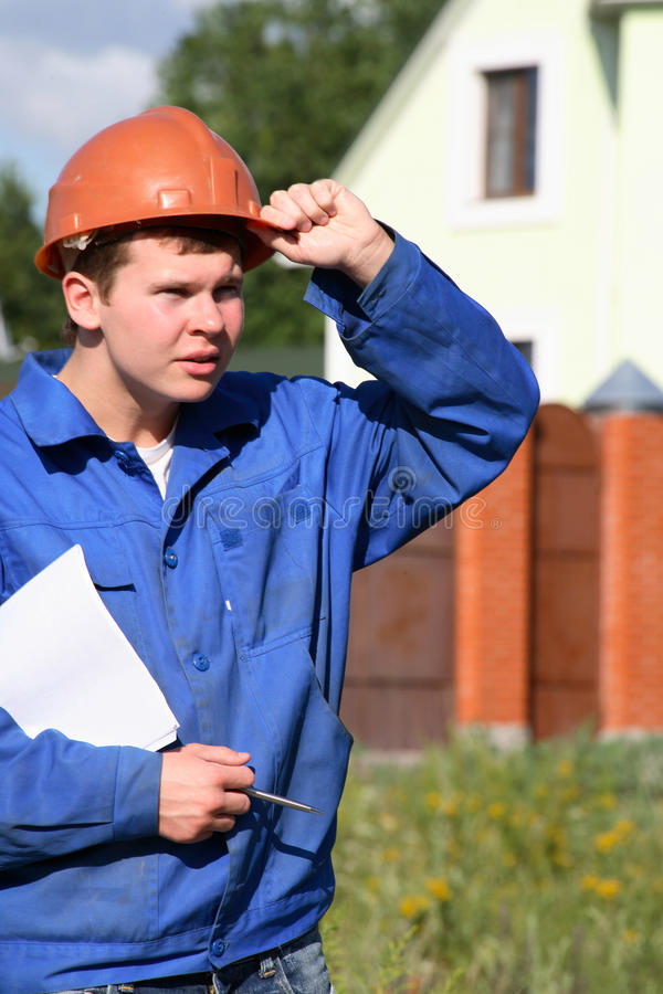 Download A Working Man With A Plan Of Construction Stock Photo - Image of cloud, looking: 12488424
