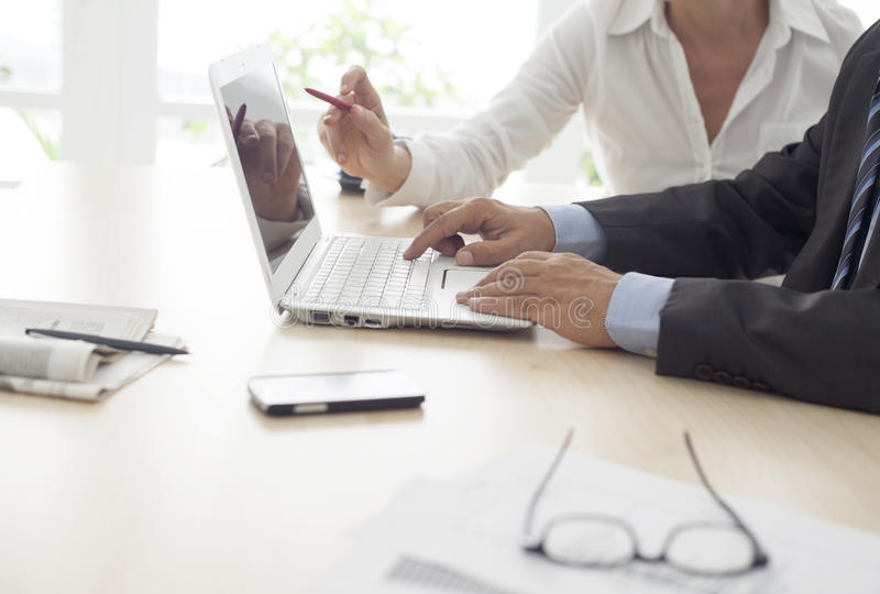 Working man and woman in the office stock photography