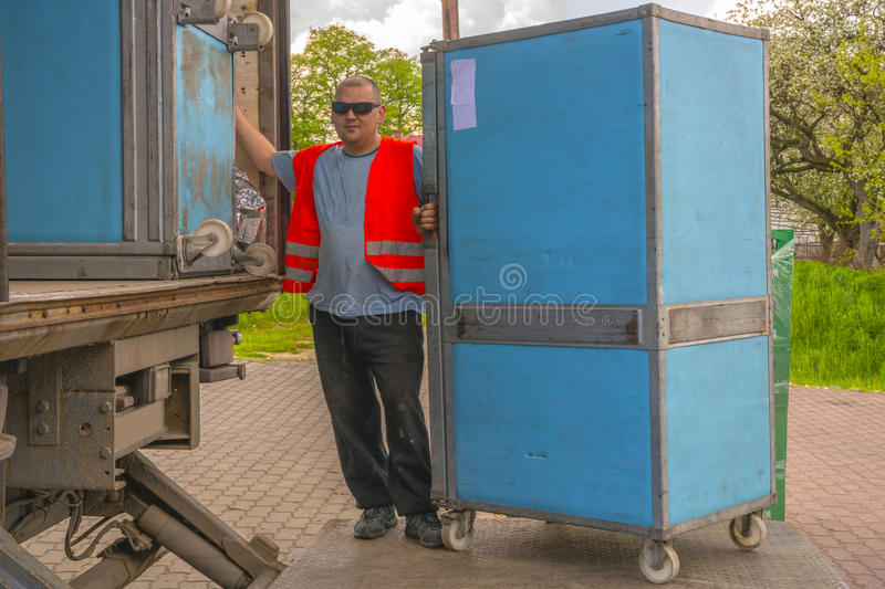 Working man. A young men packing containers for cars royalty free stock photo