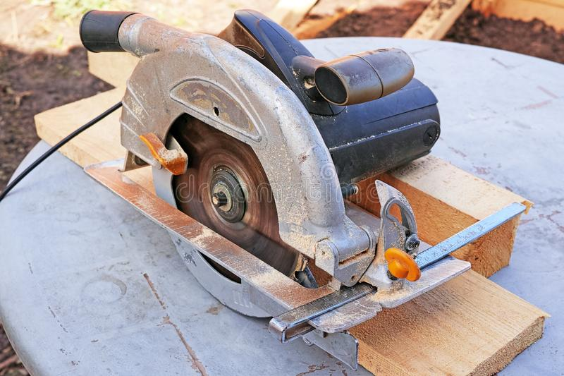 Working manual circular saw stock image