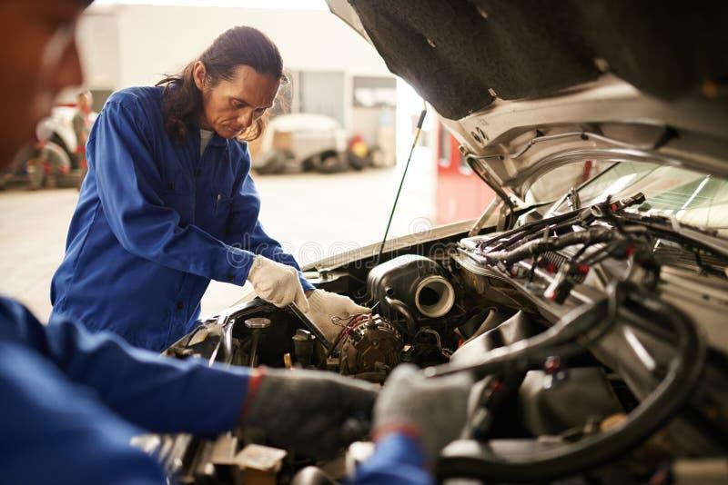 Working mechanics royalty free stock photography