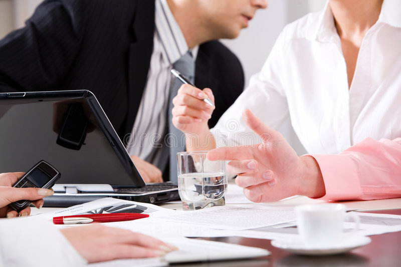 Working meeting. Photo of human hands at working meeting royalty free stock images