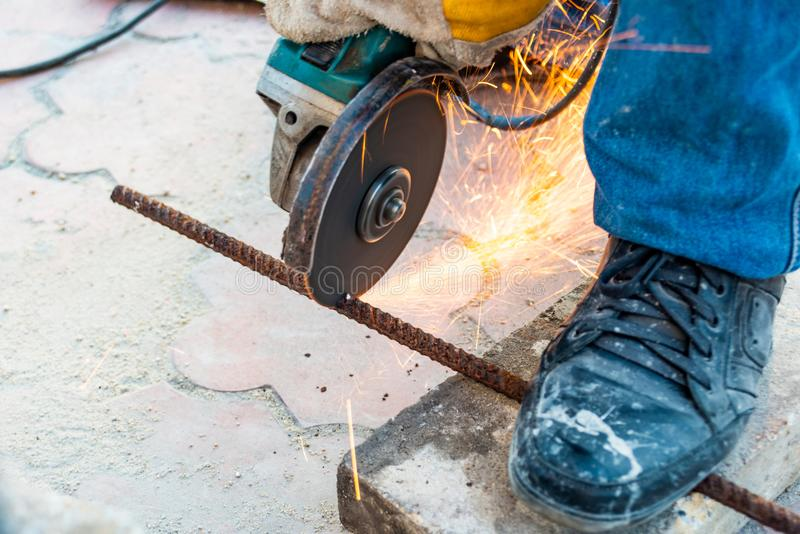 Working mode grinding machine iron rod, sparks fly in different directions. Working mode grinding machine iron rod, sparks fly in different directions stock photography