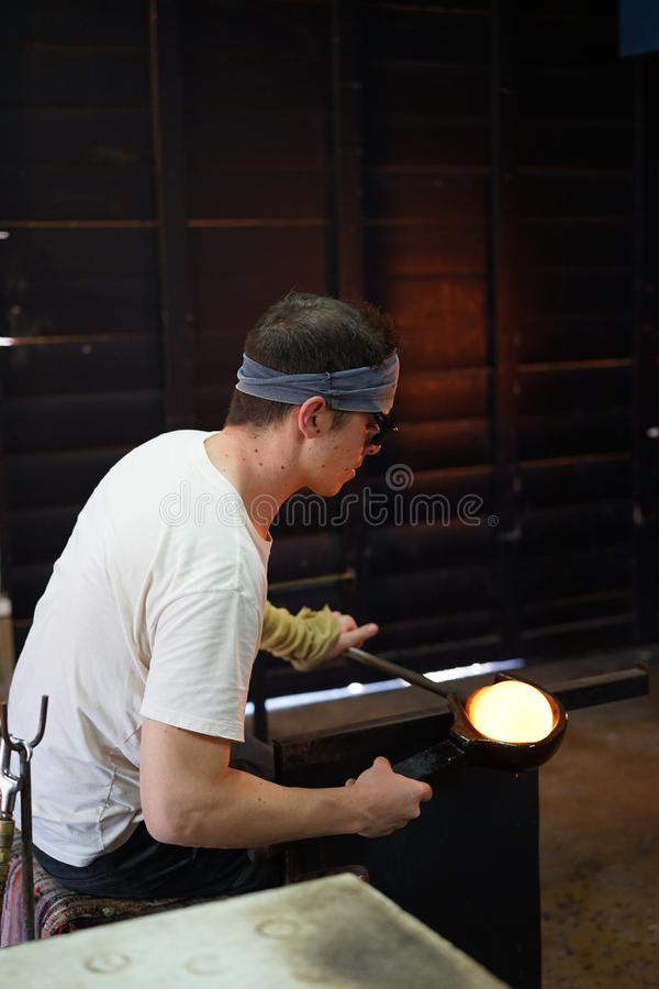 Working molten glass stock image