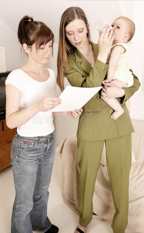 Working mother. Leaving a baby at home with a babysitter