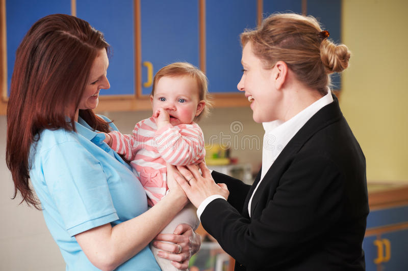 Working Mother Dropping Child At Nursery royalty free stock images
