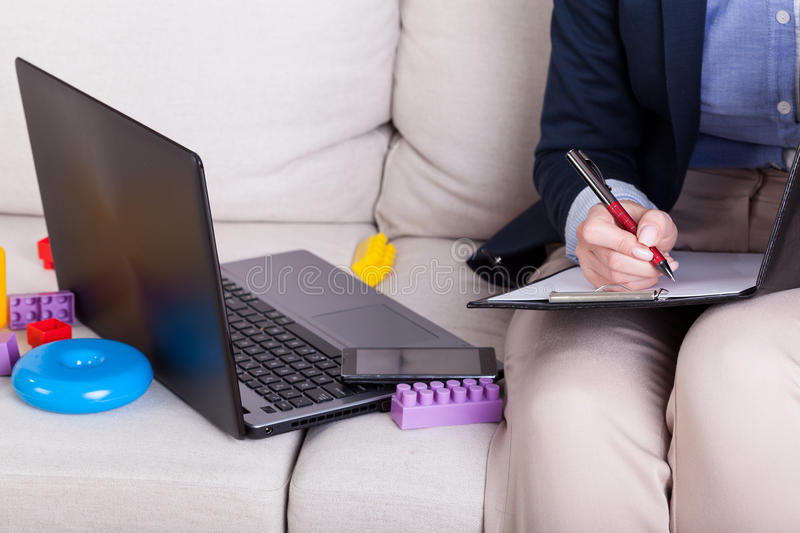 Download Working mother among toys stock photo. Image of late - 43681496