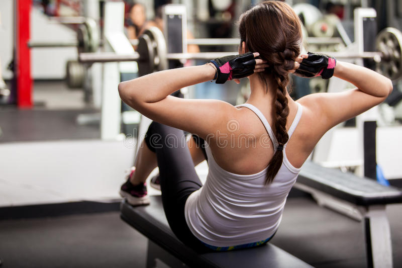 Working on my abs at the gym stock image
