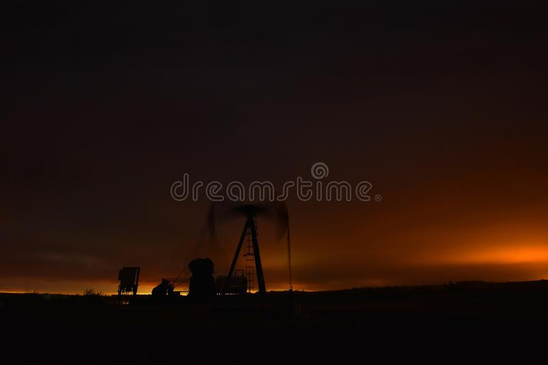 Working Oil Well Pump Jack stock photo