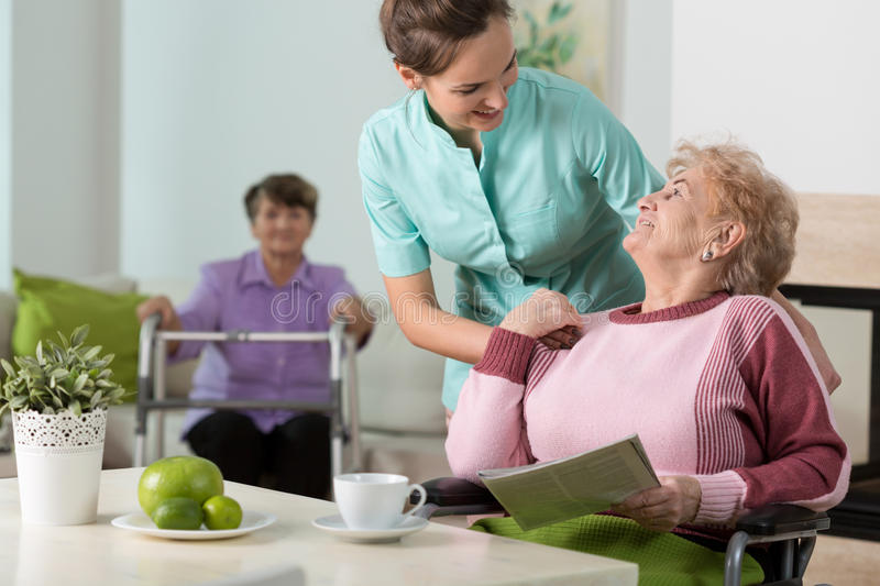 Working in old people's home royalty free stock photo