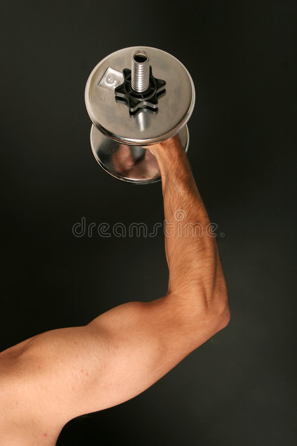 Working out with dumbbell stock image