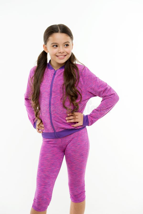 Working out with long hair. Girl cute kid with long ponytails wear sportive costume isolated on white. Sport for girls. Guidance on working out with long hair royalty free stock photos
