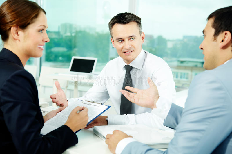 Working partners. Portrait of friendly professionals planning work in office royalty free stock images