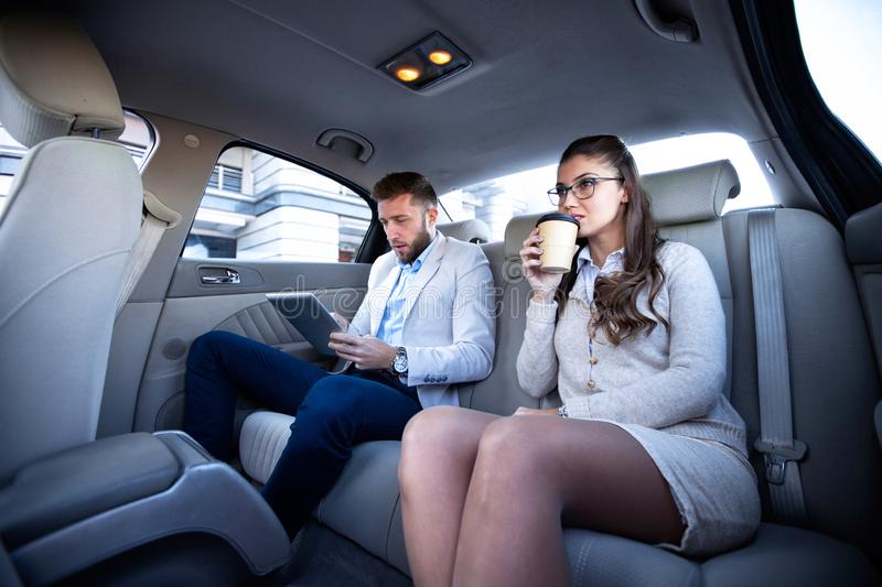 Working partners sitting in the car royalty free stock photos