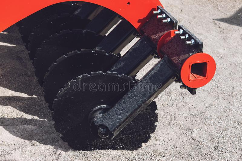 Working parts of new agricultural disc harrow. Plow. Harrow. Cultivator for cultivating the earth. Agriculture, agro, backdrop, background, black, blade, blue royalty free stock images