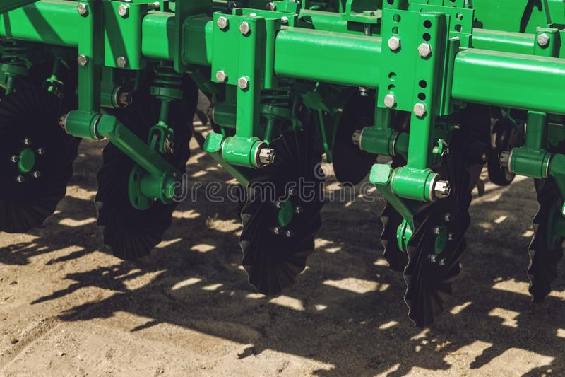 Working parts of new agricultural disc harrow. Plow. Harrow. Cultivator for cultivating the earth. Agriculture, agro, backdrop, background, black, blade, blue royalty free stock photo