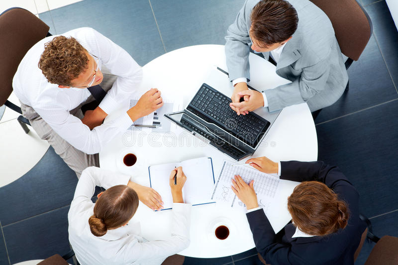 Working people. Above view of several business people planning work at round table