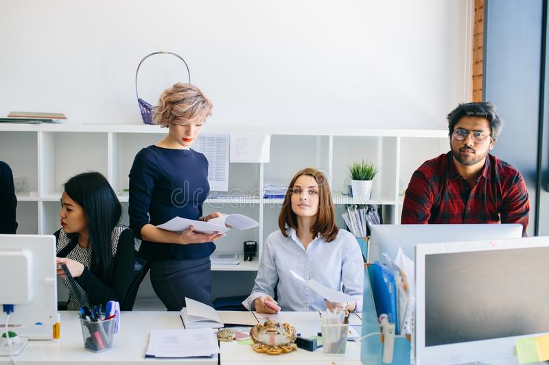 Working people in a small company. royalty free stock photo