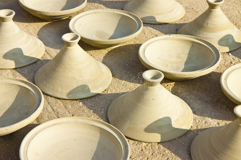 Working phase of the traditional moroccan terracotta plate, the tajine, or tagine, with which the traditional couscous dish is stock images