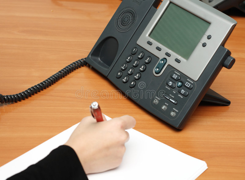 Working place. Office working place with a VoIP phone stock photography
